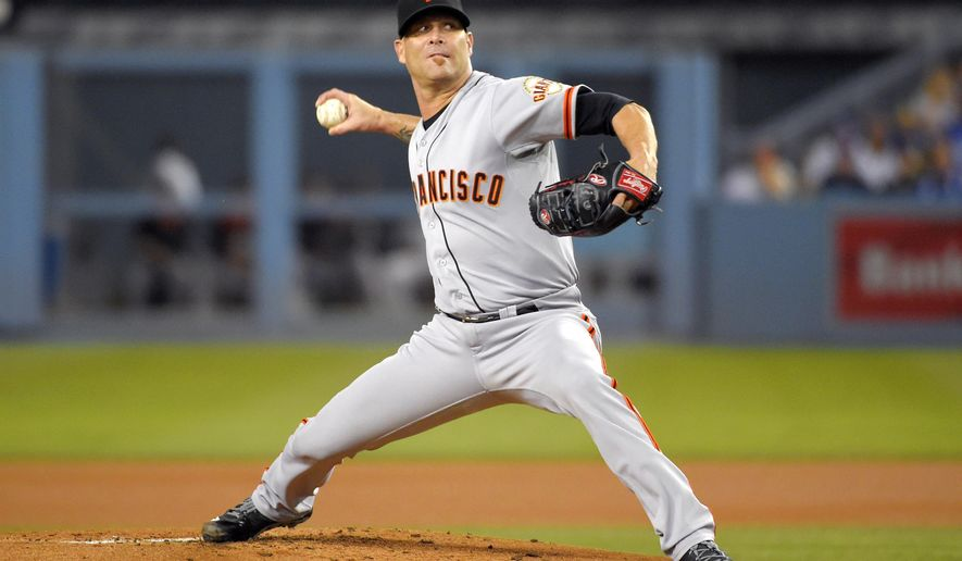 San Francisco Giants starting pitcher Tim Hudson throws to the plate during the first inning of a baseball game against the Los Angeles Dodgers, Wednesday, Sept. 24, 2014, in Los Angeles. (AP Photo/Mark J. Terrill)
