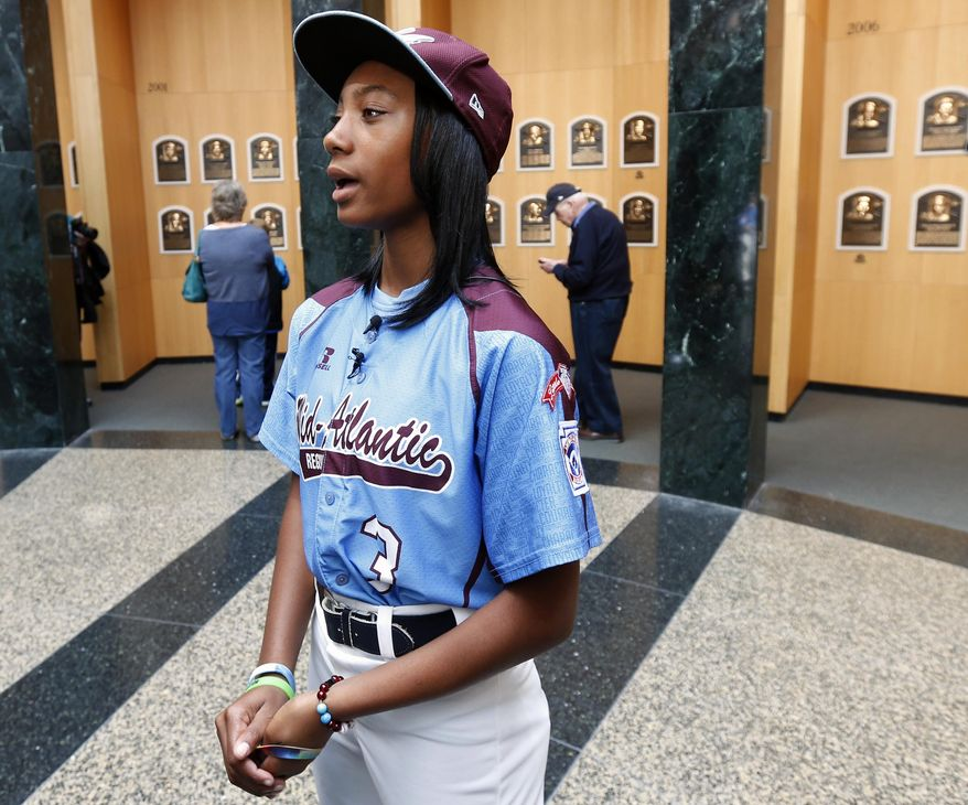 Little League pitcher Mo'ne Davis talks to reporters in the Plaque Gallery at the Baseball Hall of Fame before presenting the jersey she wore during her shutout win at the Little League World Series to the hall on Thursday, Sept. 25, 2014, in Cooperstown, N.Y. (AP Photo/Mike Groll)