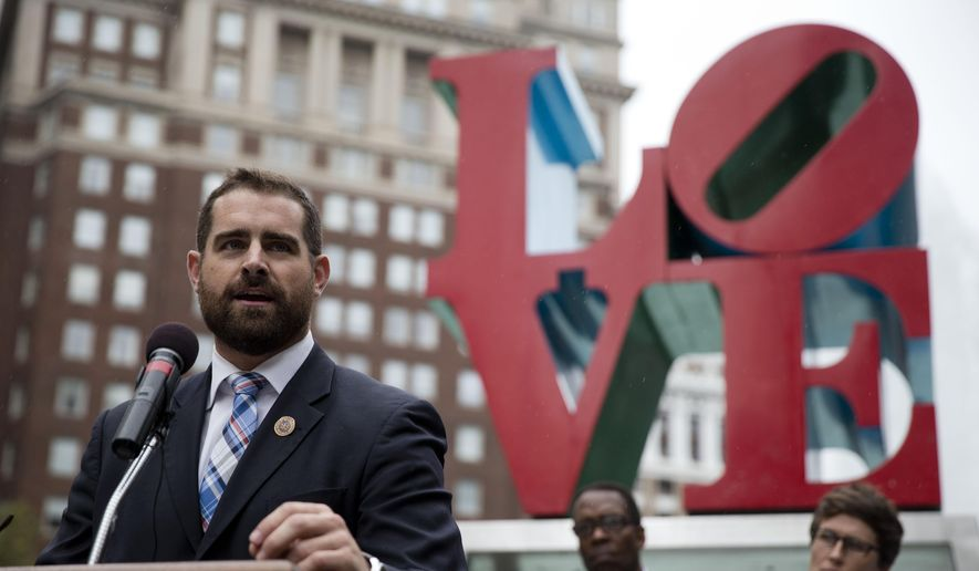 State Rep. Brian Sims, D-Philadelphia, accompanied by other officials, speaks at a protest calling on Pennsylvania to add sexual orientation to its hate crime law at John F. Kennedy Plaza, also known as Love Park, Thursday, Sept. 25, 2014, in Philadelphia. The renewed call for the legislation comes in response to the Sept. 11 beating of a gay couple. (AP Photo/Matt Rourke) ** FILE **