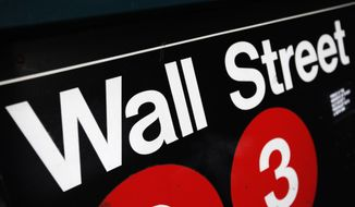 Global stocks markets were mostly higher Thursday after a surge in new U.S. home sales bolstered sentiment. But gains were limited by worries about Europe's stagnant economy and violence in Iraq and Syria. (AP Photo/Mark Lennihan, File)