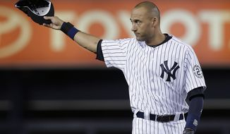 New York Yankees shortstop Derek Jeter acknowledges applause from fans as he takes the field for a baseball game against the Baltimore Orioles, Thursday, Sept. 25, 2014, in New York. The game is Jeter's last home game of his career. (AP Photo/Julie Jacobson)