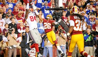 New York Giants tight end Larry Donnell (84) scores a touchdown over Washington Redskins strong safety Bashaud Breeland (26) in the second quarter as the Washington Redskins play the New York Giants in NFL football at FedExField, Landover, Md., Thursday, September 25, 2014. (Andrew Harnik/The Washington Times)