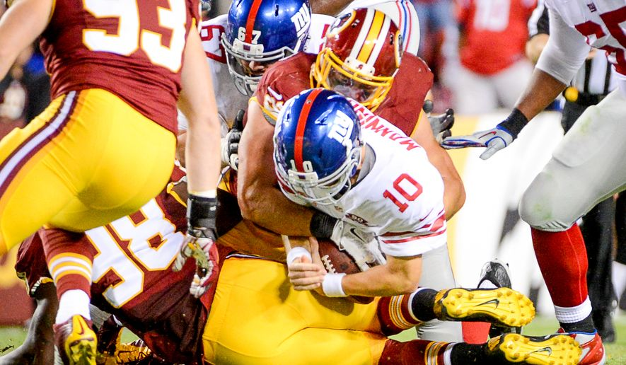 New York Giants quarterback Eli Manning (10) is sacked at the end of the second half as the Washington Redskins play the New York Giants in NFL football at FedExField, Landover, Md., Thursday, September 25, 2014. (Andrew Harnik/The Washington Times)