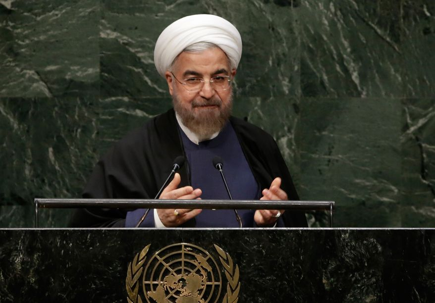 President Hassan Rouhani, of Iran, acknowledges the audience after his address to the 69th session of the United Nations General Assembly, at U.N. headquarters, Thursday, Sept. 25, 2014. (AP Photo/Richard Drew)
