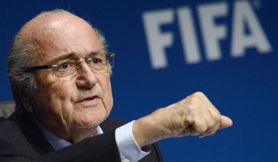 FIFA President Joseph Sepp Blatter listens to journalist's questions at a press conference following a FIFA Executive Committee meeting, on Friday, Sept.26, 2014, at the FIFA headquarters in Zurich, Switzerland. Blatter has confirmed he will stand for a fifth term as Fifa president.  (AP Photo/KEYSTONE/Steffen Schmidt)