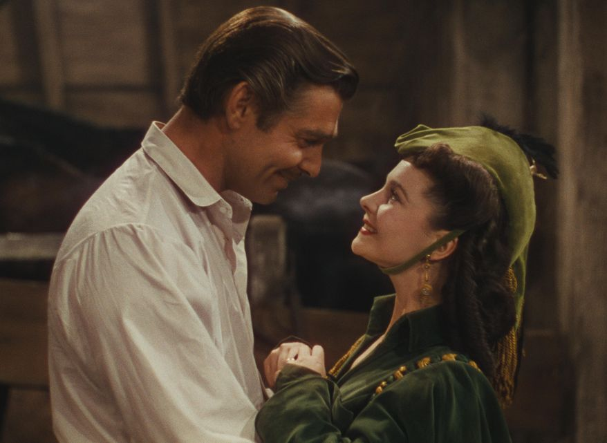 """This photo provided by Warner Bros. Home Entertainment shows Clark Gable, left,  as Rhett Butler, and Vivien Leigh as Scarlett O'Hara in a scene from the film, """"Gone With the Wind."""" The film's 75th anniversary will be celebrated over the next week, with special screenings and Warner Bros. Home Entertainment's release of a lavish new limited-edition box set. (AP Photo/Warner Bros. Home Entertainment)"""