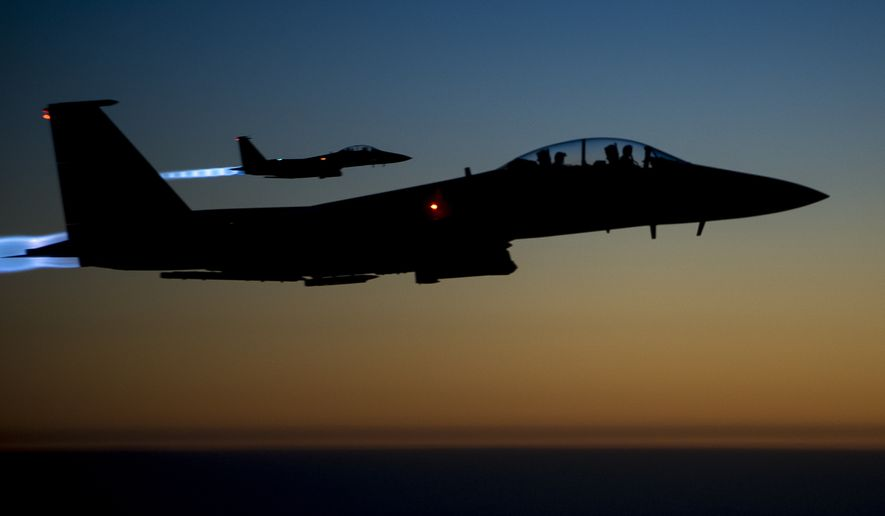A pair of U.S. F-15E Strike Eagle flies over northern Iraq, after conducting airstrikes in Syria on Sept. 23, 2014. (Associated Press)