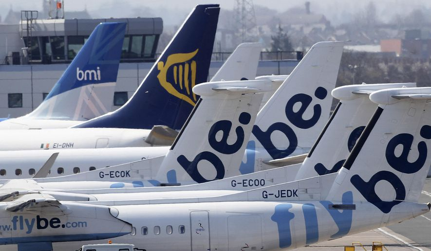 In this Thursday, April 15, 2010, file photo, grounded aircraft are seen at Belfast City airport, Northern Ireland. (AP Photo/Peter Morrison, File)
