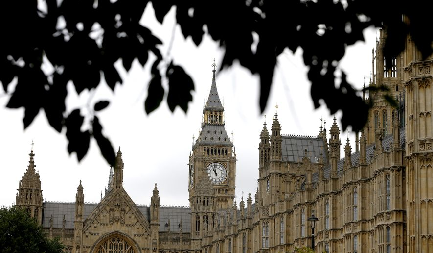 The Houses of Parliament in London, Friday, Sept. 26, 2014. Britain's Parliament is to debate and vote on the UK response to Iraqi's government's request for support against the Islamic State group. A result to the vote is expected late Friday. (AP Photo/Kirsty Wigglesworth)