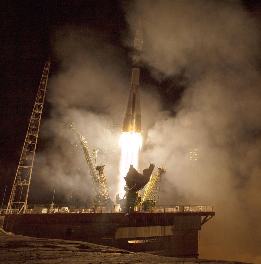 The Soyuz TMA-14M rocket launches from the Baikonur Cosmodrome in Kazakhstan for the International Space Station on Friday, Sept. 26, 2014 carrying NASA astronaut Barry Wilmore and Russians Alexander Samokutyaev and Elena Serova. Serova will become the fourth Russian woman to fly in space and the first Russian woman to live and work on the station. (AP Photo/NASA, Aubrey Gemignani)