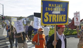 Golden Gate Ferry workers picket outside the ferry terminal during a one-day strike Friday, Sept. 26, 2014, in Larkspur, Calif. Golden Gate Ferry workers have gone on strike, shutting down commuter service between Marin County and San Francisco. Flyers were left on the seats of ferry boats letting people know that the Larkspur, Sausalito and San Francisco terminals will not be operating Friday from 4:30 a.m. until 9 p.m.  (AP Photo/Eric Risberg)