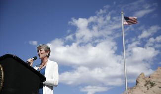 U.S. Interior Secretary Sally Jewell speaks before a ceremonial signing of a settlement with the Navajo Nation Friday, Sept. 26, 2014, in Window Rock, Ariz. in the Navajo Nation. In the settlement the Navajo Nation will receive $554 million from the federal government over mismanagement of tribal resources. (AP Photo/John Locher)