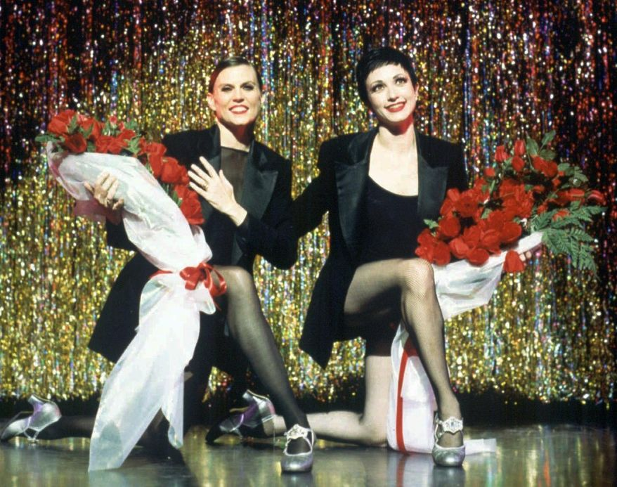"""In this 1996 file photo released by The Publicity Office, Ann Reinking, left, and Bebe Neuwirth star in the musical """"Chicago"""" at New York's Richard Rodgers Theater in New York. Original stars Reinking, Neuwirth, James Naughton and Joel Grey will be making cameos that night to celebrate the show becoming the second longest-running show in Broadway history. (AP Photo/The Publicity Office, Dan Chavkin, File)"""