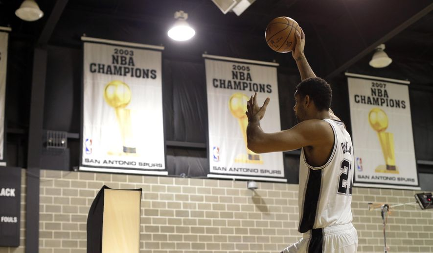 San Antonio Spurs' Tim Duncan poses for photos and video during NBA basketball media day at the team's practice facility, Friday, Sept. 26, 2014, in San Antonio. (AP Photo/Eric Gay)