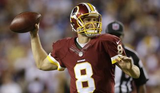 Washington Redskins quarterback Kirk Cousins (8) passes the ball during the first half of an NFL Thursday night football game against the New York Giants in Landover, Md., Thursday, Sept. 25, 2014. (AP Photo/Patrick Semansky)