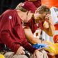 Washington Redskins head coach Jay Gruden and offensive coordinator Sean McVay talks with Washington Redskins quarterback Kirk Cousins (8) after he throws his fourth interception as the Washington Redskins play the New York Giants in NFL football at FedExField, Landover, Md., Thursday, September 25, 2014. (Andrew Harnik/The Washington Times)
