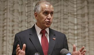 North Carolina Republican Senate candidate Thom Tillis answers a question from the media during a news conference in Greensboro, N.C., Friday, Sept. 26, 2014. (AP Photo/Chuck Burton)