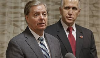 Sen. Lindsey Graham (R-SC), left, speaks to the media about national security as North Carolina Republican Senate candidate Thom Tillis, right, listens, during a news conference in Greensboro, N.C., Friday, Sept. 26, 2014. (AP Photo/Chuck Burton) ** FILE**