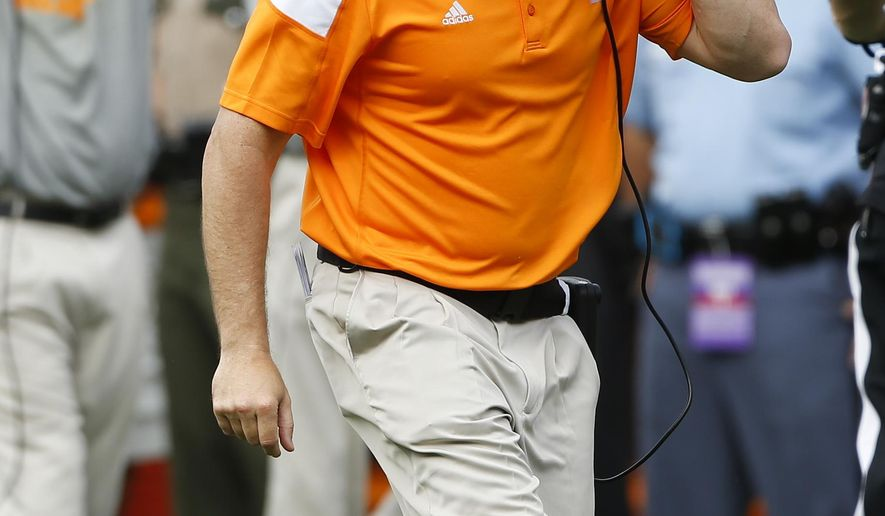 Tennessee head coach Butch Jones yells at an official during the second half of an NCAA college football game against Georgia, Saturday, Sept. 27, 2014, in Athens, Ga. Georgia won 35-32. (AP Photo/John Bazemore)