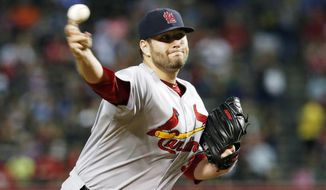 St. Louis Cardinals' Lance Lynn throws a pitch against the Arizona Diamondbacks during the first inning of a baseball game Saturday, Sept. 27, 2014, in Phoenix. (AP Photo/Ross D. Franklin)