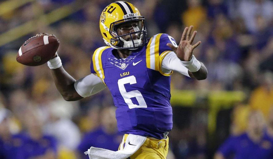LSU quarterback Brandon Harris (6) throws a touchdown pass to wide receiver Malachi Dupre, not pictured, in the first half of an NCAA college football game in Baton Rouge, La., Saturday, Sept. 27, 2014. (AP Photo/Gerald Herbert)