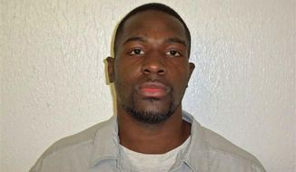 This March 21, 2011, photo provided by the Oklahoma Department of Corrections shows Alton Nolen, of Moore, Okla. Prison records indicate that Nolen, the suspect in the beheading of a co-worker at an Oklahoma food processing plant Thursday, Sept. 25, 2014, had spent time in prison and was on probation for assaulting a police officer. (AP Photo/Oklahoma Department of Corrections)