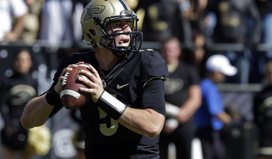 Purdue quarterback Danny Etling drops back to throw against Iowa during the second half of an NCAA college football game in West Lafayette, Ind., Saturday, Sept. 27, 2014. Purdue defeated Iowa 24-10. (AP Photo/Michael Conroy)