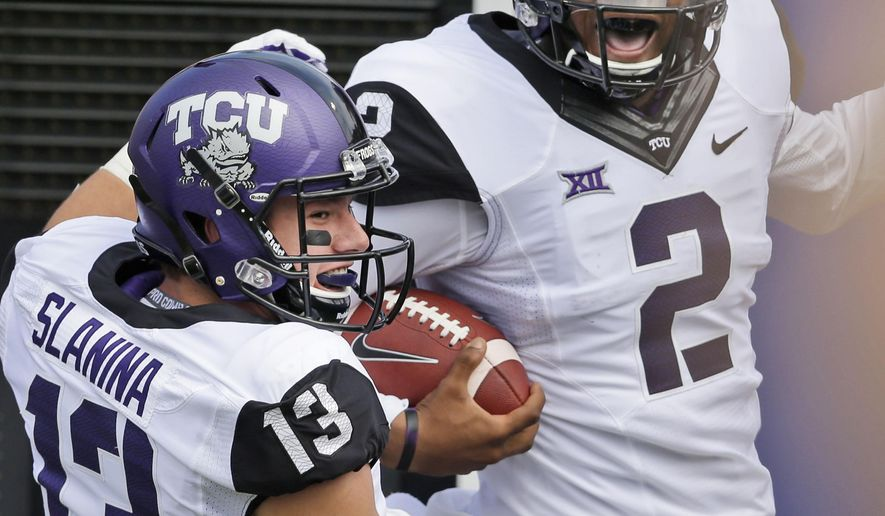 TCU quarterback Trevone Boykin (2) celebrates his 27-yard touchdown run with teammate Ty Slanina (13) during the first half of an NCAA college football game against TCU Saturday, Sept. 27, 2014, in Dallas. (AP Photo/LM Otero)