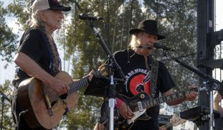 Willie Nelson and Neil Young perform at the Harvest the Hope concert in Neligh, Neb. on Saturday, Sept. 27, 2014. The concert in northeast Nebraska was organized to raise money for efforts opposing the Keystone petroleum pipeline. (AP Photo/Dave Weaver)