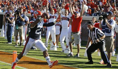 Virginia running back Khalek Shepherd (23) scores during the first half of an NCAA college football game against Kent State in Charlottesville, Va., Saturday, Sept. 27, 2014.   (AP Photo/Steve Helber)