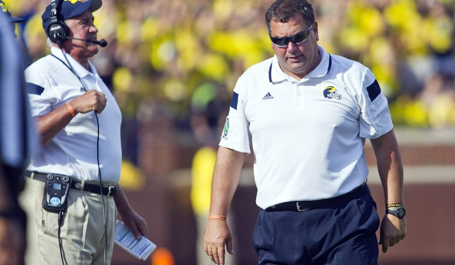 Michigan head coach Brady Hoke, right, reacts on the sideline next to defensive coordinator Greg Mattison, left, in the second quarter of an NCAA college football game against Minnesota in Ann Arbor, Mich., Saturday, Sept. 27, 2014. (AP Photo/Tony Ding)