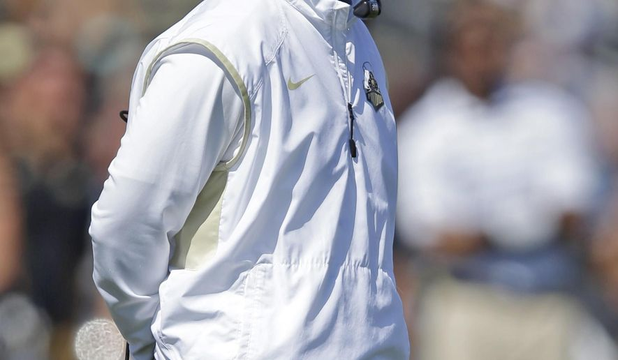 Purdue head coach Darrell Hazell watches a replay during the second half of an NCAA college football game against Iowa in West Lafayette, Ind., Saturday, Sept. 27, 2014. Purdue defeated Iowa 24-10. (AP Photo/Michael Conroy)