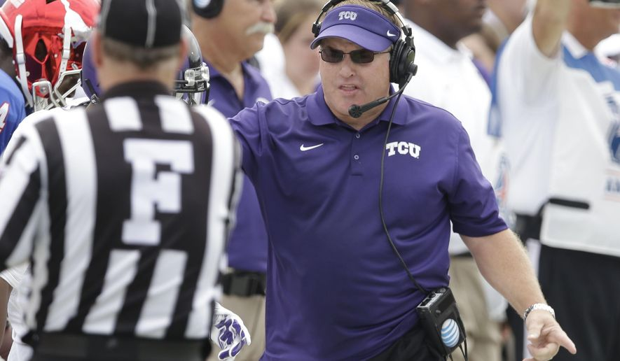 TCU head coach Gary Patterson makes a point with an official during the first half of an NCAA college football game against SMU Saturday, Sept. 27, 2014, in Dallas. (AP Photo/LM Otero)