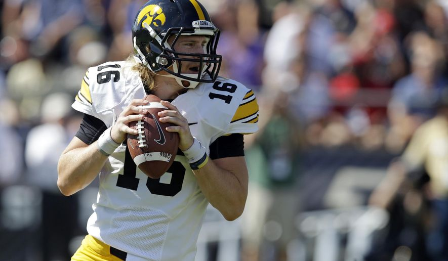 Iowa quarterback C.J. Beathard  drops back to throw against Purdue during the first half of an NCAA college football game in West Lafayette, Ind., Saturday, Sept. 27, 2014. (AP Photo/Michael Conroy)