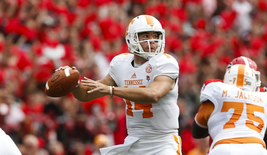 Tennessee quarterback Justin Worley (14) throws from the pocket during the first half of an NCAA college football game against Georgia, Saturday, Sept. 27, 2014, in Athens, Ga. (AP Photo/John Bazemore)