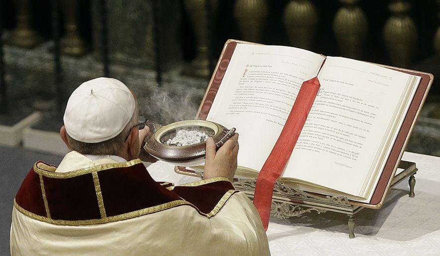 Pope Francis attends a Vespers prayer in the Church of Jesus, in Rome, Saturday, Sept. 27, 2014. (AP Photo/Gregorio Borgia)