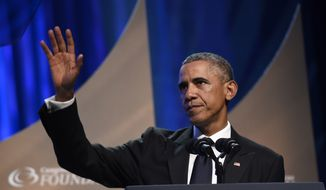 President Barack Obama waves to the crowd after speaking at the Congressional Black Caucus Foundation's 44th Annual Legislative Conference Phoenix Awards Dinner in Washington, Saturday, Sept. 27, 2014. Obama told the audience that the mistrust of law enforcement that was exposed after the fatal police shooting in Ferguson, Missouri, has a corrosive effect on all of America, not just on black communities. (AP Photo/Susan Walsh)