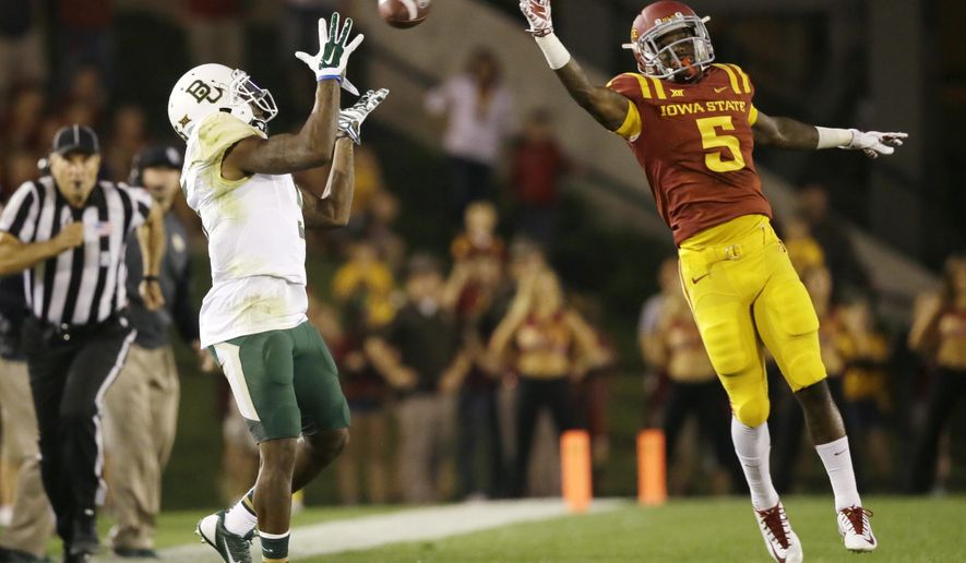 Baylor wide receiver Antwan Goodley, left, catches a pass in front of Iowa State defensive back Kamari Cotton-Moya (5) during the first half of an NCAA college football game, Saturday, Sept. 27, 2014, in Ames, Iowa. (AP Photo/Charlie Neibergall)