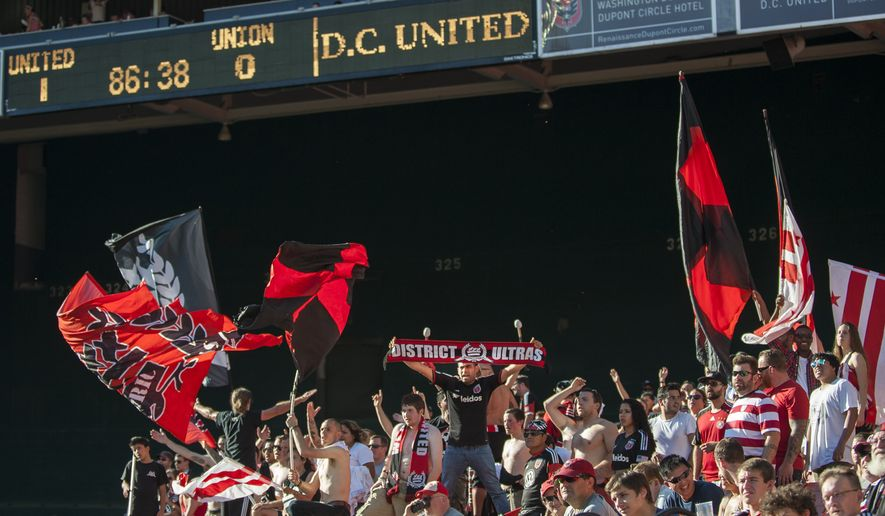 D.C. United Fans cheer on their team on Saturday, Sept. 27, 2014 at RFK Stadium in Washington D.C. Luis Silva's goal in the 10th minute was enough to lift United to a 1-0 win over the Philadelphia Union at RFK Stadium. (Pete Marovich for the Washington Times)