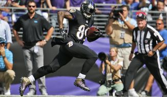 Baltimore Ravens wide receiver Steve Smith (89) heads toward the end zone for a touchdown during the first half of an NFL football game against the Carolina Panthers in Baltimore, Sunday, Sept. 28, 2014. (AP Photo/Evan Vucci)