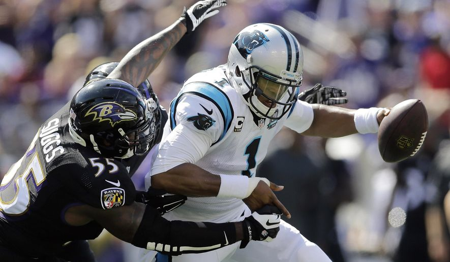 Carolina Panthers quarterback Cam Newton (1) is sacked by Baltimore Ravens outside linebacker Terrell Suggs (55) during the first half of an NFL football game in Baltimore, Sunday, Sept. 28, 2014. (AP Photo/Patrick Semansky)