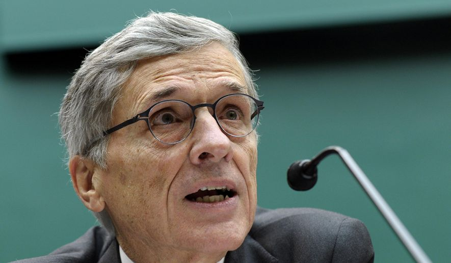 Federal Communications Commission (FCC) Chairman Tom Wheeler testifies on Capitol Hill in Washington in this Thursday, Dec. 12, 2013, file photo. (AP Photo/Susan Walsh, File)