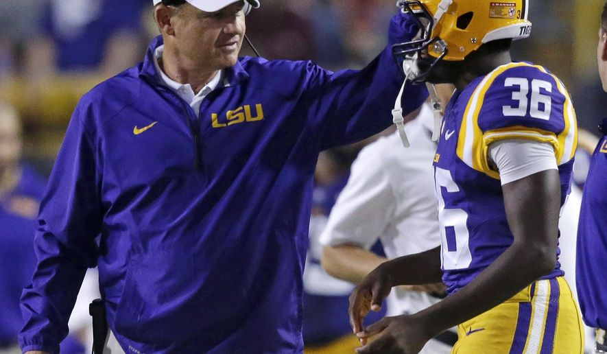 LSU coach Les Miles talks with kicker Cameron Gamble (36) in the second half of an NCAA college football game against New Mexico State in Baton Rouge, La., Saturday, Sept. 27, 2014. LSU won 63-7. (AP Photo/Gerald Herbert)