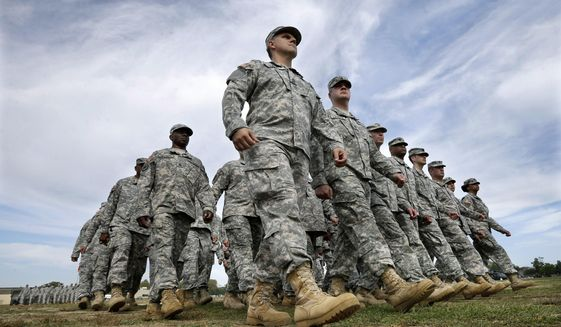 New Jersey National Guard troops march as they pass in review during the New Jersey National Guard's annual Military Review Sunday, Sept. 28, 2014, in Sea Girt, N.J. (AP Photo/Mel Evans) **FILE**