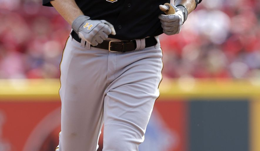 Pittsburgh Pirates' Neil Walker rounds the bases after hitting a solo home run off Cincinnati Reds starting pitcher Johnny Cueto in the fourth inning of a baseball game, Sunday, Sept. 28, 2014, in Cincinnati. (AP Photo/Al Behrman)
