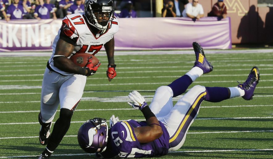 Atlanta Falcons wide receiver Devin Hester (17) runs from Minnesota Vikings defensive end Everson Griffen (97) during 36-yard touchdown reception in the second half of an NFL football game, Sunday, Sept. 28, 2014, in Minneapolis. (AP Photo/Ann Heisenfelt)