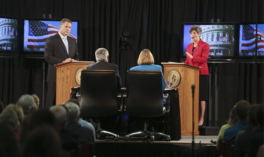 """Iowa state Sen. Joni Ernst (right), republican candidate for U.S. Senate, sparred with democratic candidate U.S. Rep. Bruce Braley on Sunday, over immigration and the definition of """"amnesty."""" The Des Moines Register released a poll over the weekend that showed Mrs. Ernst had opened up a 6-percentage-point lead over Mr. Braley. (Associated Press)"""
