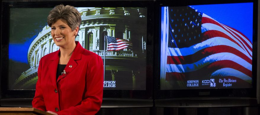 A political science professor at Iowa State University, said Democrats are turning to the Koch attacks in Iowa in hopes of raising questions about the trustworthiness of Republican candidate Joni Ernst. (AP Photo/The Des Moines Register, Andrea Melendez)