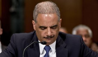 This June 6, 2013, file photo shows U.S. Attorney General Eric Holder testifying on Capitol Hill in Washington before a Senate Appropriations subcommittee. (AP Photo/J. Scott Applewhite, File)