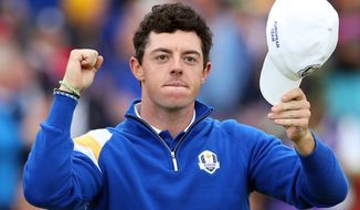 Europe's Rory McIlroy celebrates winning his match against Rickie Fowler of the US on the 14th hole during the singles match on the final day of the Ryder Cup golf tournament, at Gleneagles, Scotland, Sunday, Sept. 28, 2014. (AP Photo/Peter Morrison)